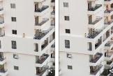 Thót tim cảnh bé gái lao băng băng trên gờ tường chung cư