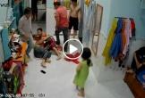 Phẫn nộ 2 người đàn ông hành hung người phụ nữ